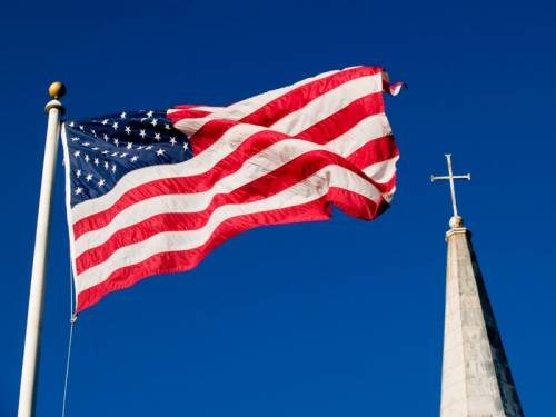 U.S. flag and church steeple