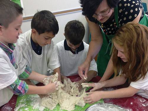 Children mixing bread dough