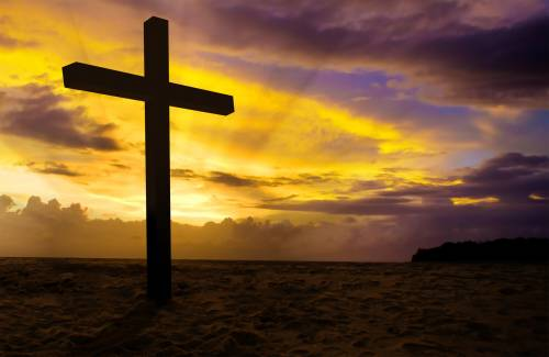 christian cross on sunset background