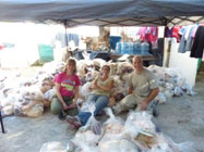 The Rev. Kim Wadlington, Presbytery of Carlisle; Tracey King-Ortega, Presbyterian World Mission regional liaison for Central America; and the Rev. Mark Englund-Kreiger, executive presbyter, Presbytery of Carlisle, with packages of basic foods (rice, beans, corn, oil, coffee, sugar) to distribute alongside Presbyterian Women of the Church of Honduras to six rural communities affected by drought. (Photo provided)