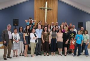 "Pastor Tim McCalmont (center left), with Syrians after their Arabic-language Easter season worship, says, ""We're grateful God dropped what has become a life of its own into our laps."""