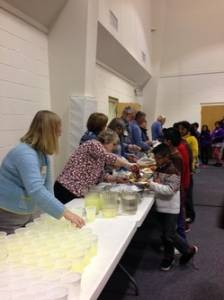 Church volunteers provide refreshments for students participating in an after-school tutoring program.