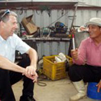 John McCall talks with a Bunun tribal elder in Taiwan.