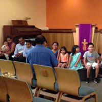 Pastor Miguel Estrada talking to children at Cypress Lake Presbyterian Church (Photo by Jessica Osegueda)