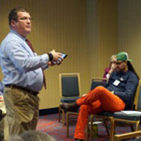 Gordon Mikoski, associate professor of Christian education at Princeton Theological Seminary, speaks at the 2016 APCE meeting in Chicago. Mark Hinds (seated at left) also spoke during a workshop on the Confirmation Project. — Emily Enders Odom