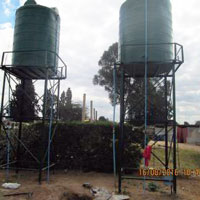Twin water storage tanks. One tank supplies spigots on the grounds of Mabvuku UPCSA; the other serves community taps. (Photo by Talkmore Chilanga)