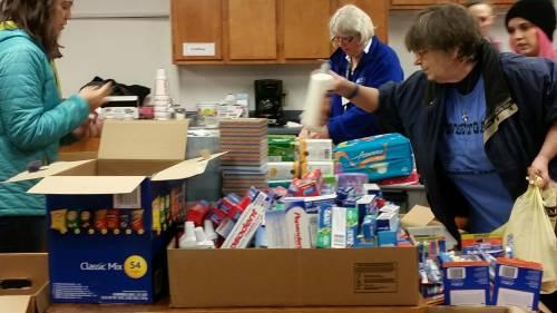 Volunteers sort goods donated to Gatlinburg at the Sunset Gap Community Center. (Photo by Dave Doehnert, NRT member)