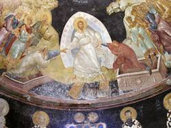 A representation of Jesus clothed in white and surrounded by people.