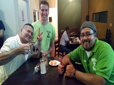 Migrant Resource coordinators Betto (r) and Chris (c) celebrate the 10th Anniversary with volunteer Noe
