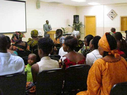 "Rev. Gisonga ""Aaron"" Ruvugwa leads worship at the Agape African Fellowship. (Photo by Betsy Garrett)"