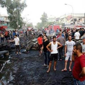 People survey the damage following a deadly bombing in Baghdad's Karada market.