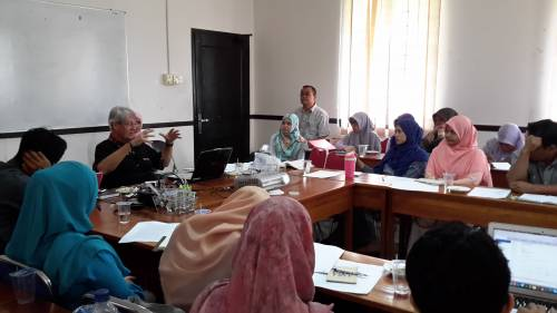 Bernard Adeney-Risakotta (left), mission co-worker and professor of religion, ethics and social sciences with the Indonesian Consortium for Religious Studies, teaches a class in Indonesia. Photo by Farsijana Adeney-Risakotta.