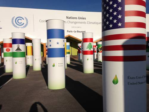 Flags on display outside COP 21 in Paris in 2015. (Photo by Rebecca Barnes)