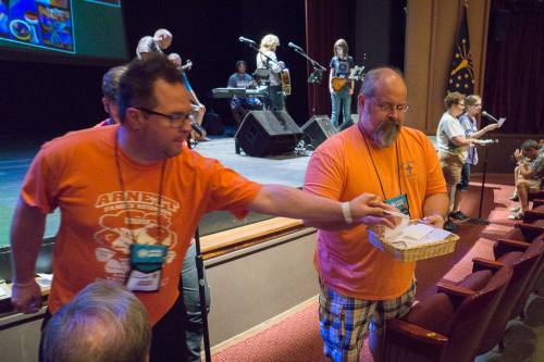 Participants place sheets of on which they've written a prayer of whey they hope to see Jesus this week at Presbyterian Youth Triennium. (Photo by Gregg Brekke)