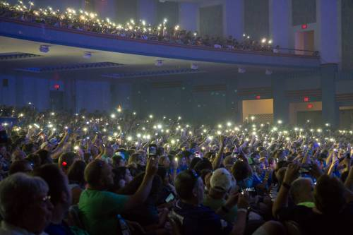 Presbyterian Youth Triennium attendees hold their cell phones up during a opening song at Wednesday's worship service. (Photo by Gregg Brekke)