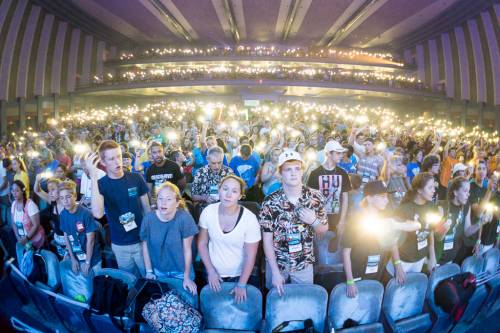 Worshipers hold their cell phone lights up during the song 'Come as you are' at Thursday's Presbyterian Youth Triennium worship service. (Photo by Gregg Brekke)
