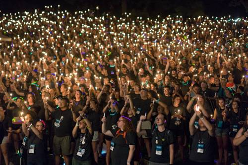 Presbyterian Youth Triennium participants hold candles high at the conclusion of Friday evening's worship service. (Photo by Gregg Brekke)