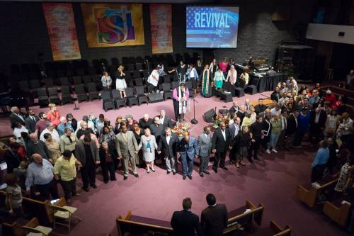 Clergy gather at the front of the sanctuary at St. Stephen Baptist church during the October 4 'Moral Revival' committing to preach and act on Christian moral principles. (Photo by Gregg Brekke)