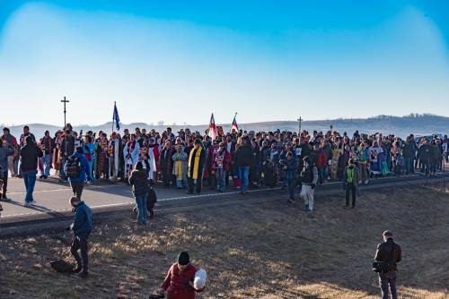 Faith leaders amass on the road leading to the bridge over the Cannon Ball river that has been the site of unrest over the past six months. (Photo by Gregg Brekke)