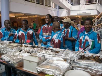 Members of the Malawi Mission Network, visiting from the Blantyre Synod in Malawi, prepare to fill their plates with authentic Malawian food. Photo by Carl Suppo.,