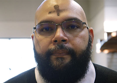 A forehead marked with an ash cross.