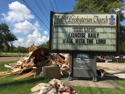 Rubble taken from the church sits outside Faith Presbyterian Church in Baton Rouge, Louisiana. (Photo by Paul Seebeck)