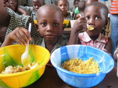 Children eating lunch at Hope Mission School, a rural primary and secondary school supported by Westminster Presbyterian Church of Albany, New York. The connection with this school started because of a Liberian-American who is a member of Westminster.