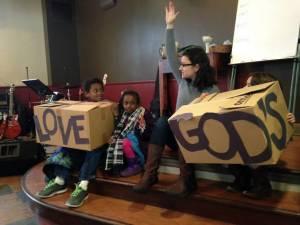 Pastor Jennifer Frayer-Griggs leads a children's moment at Hot Metal Bridge.