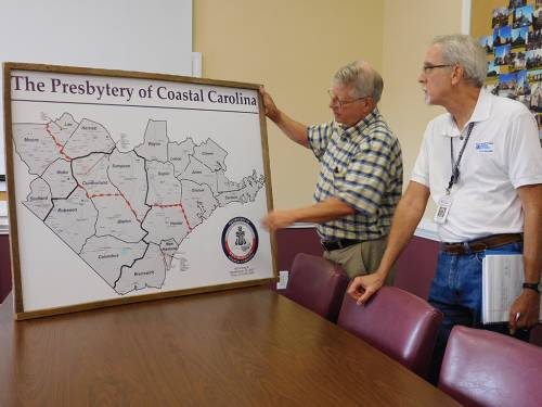 PDA National Response Team Lead Jim Reinarz with Bill Reinhold, general presbyter with the Presbytery of Coastal California, review a map of the flood areas hit by Hurricane Matthew. (Photo by Lynn Nakasian)