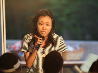 Sera Chung singing at karaoke night at Big Tent.