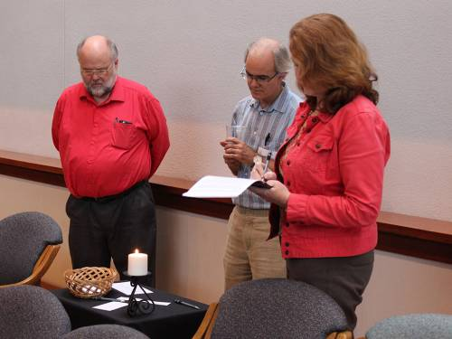 The prayer vigil ended with participants going to one of four prayer stations in the chapel. (Photo by Rick Jones)
