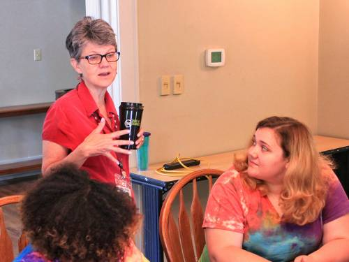 Anne McKee, Campus Minister at Maryville College, works with a student and her mentor during one the breakout sessions for Expanding Horizons 2016. (Photo provided)