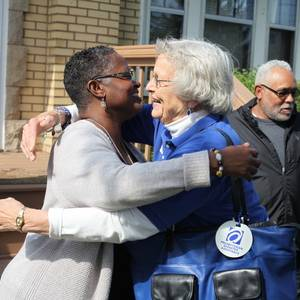 Rev. Desiree Lawson of Trinity United Presbyterian Church and Gail Farnham of PDA Disaster Response Team embrace in Flint, Mich. Photo by Mike Fitzer