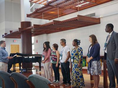 Photo Caption: Carl Horton (left), coordinator for the Presbyterian Peacemaking Program, commissions the 2016 International Peacemakers at the PMA Chapel. (Photo by Mari Graham)