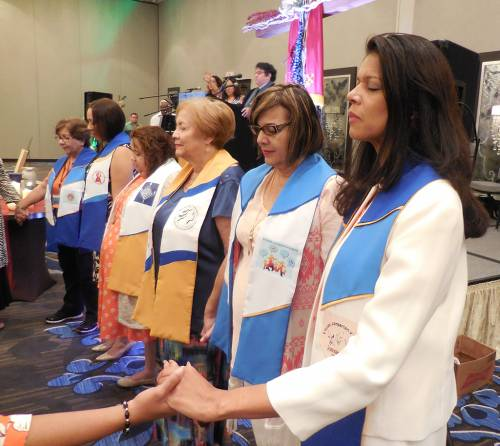 Installation of the newly elected Coordinating Team during the closing worship service. (From right) Ruth Román-Meza, Moderator; Iris González Cabán, Vice Moderator; Nydia Murphy-Leger, Treasurer; Danilie C.Hilerio Villanueva, Spiritual Coordinator; Keren Díaz-Orozco, Secretary; Elizabeth Torres, Hispanic Representative on Presbyterian Women's Churchwide Coordinating Team. (Photo provided)