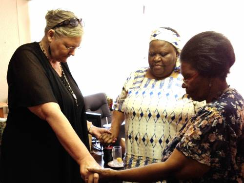 Mission co-worker Janet Guyer (left) with Buyelwa Maringa (right), co-facilitator for Footprints training with Maureen (center). (Photo provided)
