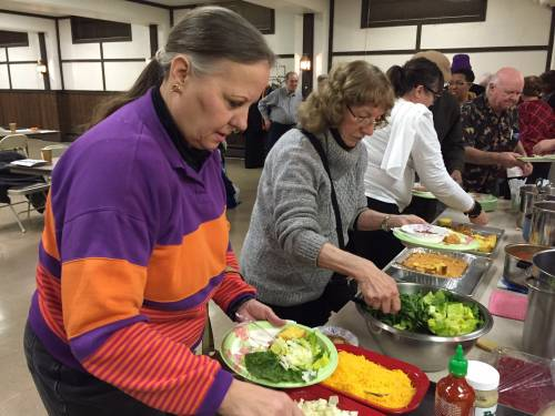 Members and guests enjoy the Monday evening community dinner at First Presbyterian Church of Homewood, Illinois. (Photo by Nancy Jo Dederer)