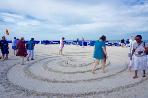Worshipers walk a spiral path in the sand to the center at the Spiral Walk Station. Photo by Mari Graham.