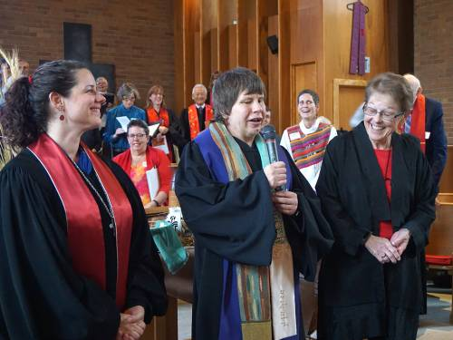 Lisa Larges (center) offers charge and blessing at the conclusion of her ordination service, Sunday, Oct. 30, 2016, with Kara Root and Mardee Rightmyer. (Photo by Emily Enders Odom)