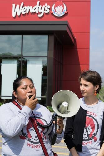 Coalition of Immokalee Workers representative Lupe Gonzalo speaks to demonstrators in front of Wendy's flagship store in Dublin, Ohio, their the company's headquarters.