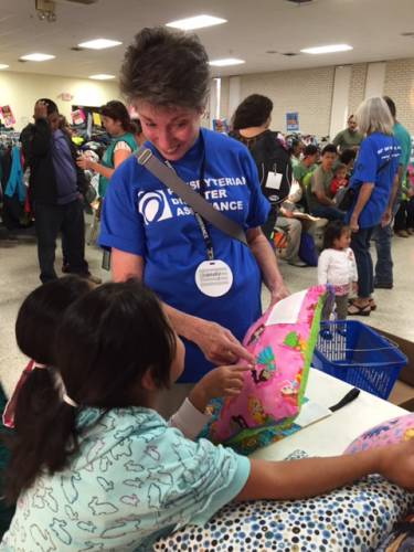 Another child receives a pillow from 'The Pillow Project' as they travel across the U.S. (Photo by Carolyn Thalman)