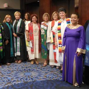 Ministers of Word and Sacrament line up to process for worship. (From left) Ruth Santana-Grace, Nydia Fernández, Carmen J. Torres-Cordero, Carmen Rosario Riviere, Sebastiana Javier (Lay Leader and International Guest from the Association of evangelical women in the Dominican Republic), Amy Méndez, Reyna Mairena, Margarita Reyes, Magdalena García, Jeniffer Rodríguez-Michel, and Marissa Galván-Valle. (Photo provided)