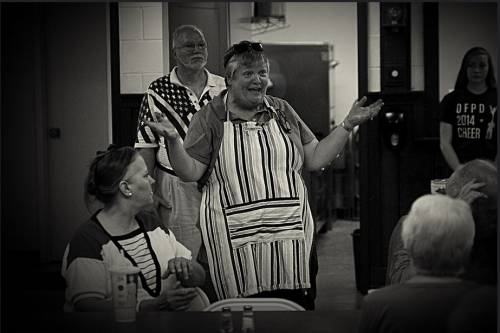 Pastor Nancy Jo Dederer offers a blessing before the community dinner at First Presbyterian Church of Homewood, Illinois. (Photo by Frank Casella)