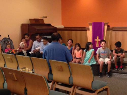 Pastor Miguel talking to Children at Cypress Lake Presbyterian Church. (Photo by Jessica Osegueda)