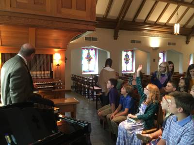 Tom Froehlich demonstrates how the organ works during the first session of 'Waffles and Worship' in the chapel of FPC Dallas on Aug. 21. (Photo provided)