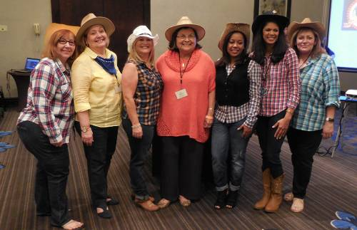Outgoing Coordinating Team enjoys a Western night, and celebrates 21 years of MHLP. (From left) Carmen Jeannette Torres, Marta Rodríguez, Yudyt Bermúdez, Dahlia Vega, Letty Heredia, Ruth Román-Meza, and Esther González. (Photo provided)