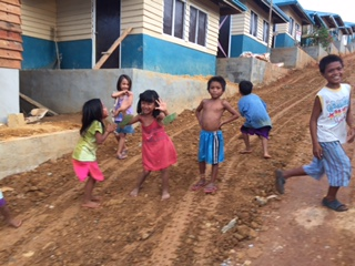 Children play in a village on the island of Samar, relocated after Haiyan. (Photo by Lori Kraus)