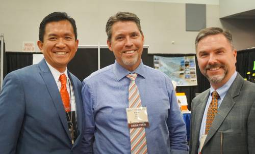Burton Webb (center) with the Rev. Neal D. Presa (left), moderator of the 220th General Assembly (2012) and Jeffrey E. Arnold (right), executive director of APCU in the Assembly's Exhibit Hall. Photo by Emily Enders Odom.