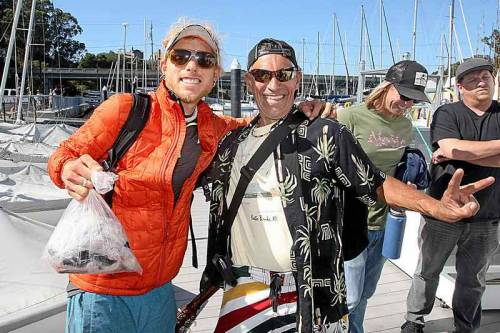 Ryan Althaus of Sweaty Sheep, holds a bag of rock fish filets caught last Monday on a boat the Christian group chartered to take two dozen homeless fishing for the day on Monterey Bay, later hosting a fish dinner on the beach. (Photo by Dan Coyro, Santa Cruz Sentinel)