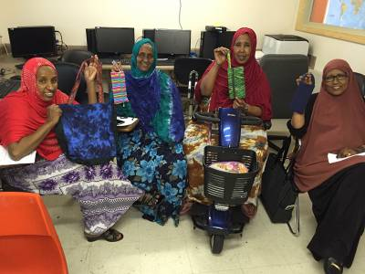 Participants in the Sewing Cooperative at Capital Park, showcase their products. (Photo courtesy of Capital Park)